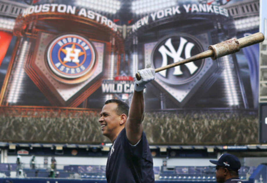 New York Yankees designated hitter Alex Rodriguez swings his bat with a weight on it before taking swings in the cage during a workout day Monday, Oct. 5, 2015, for Tuesday's American League Wild Card game at Yankee Stadium in New York. (AP Photo/Kathy Willens)