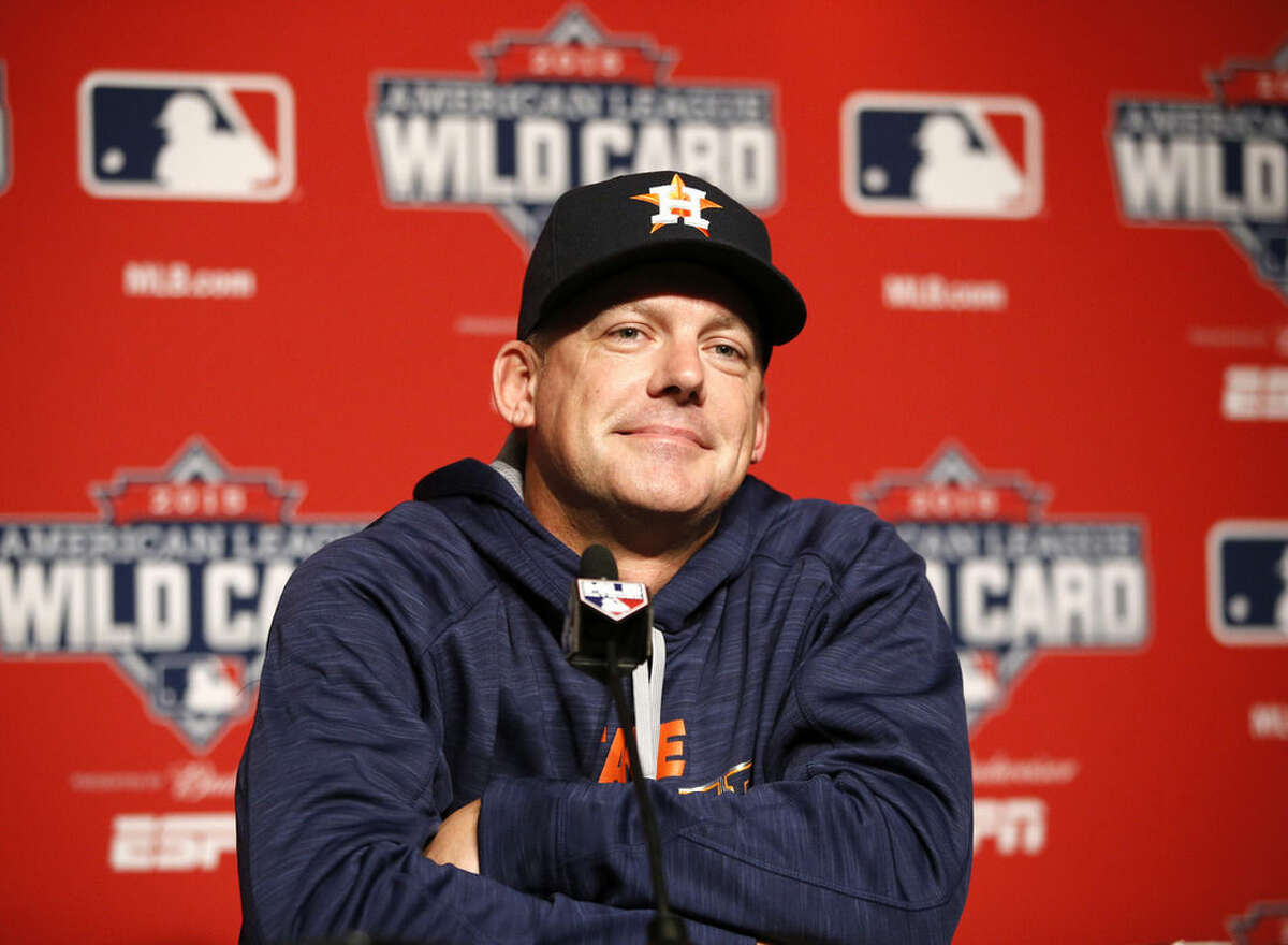 Houston Astros manager A.J. Hinch smiles during a press conference on workout day Monday, Oct. 5, 2015, for Tuesday's American League Wild Card game against the New York Yankees at Yankee Stadium in New York. (AP Photo/Kathy Willens)