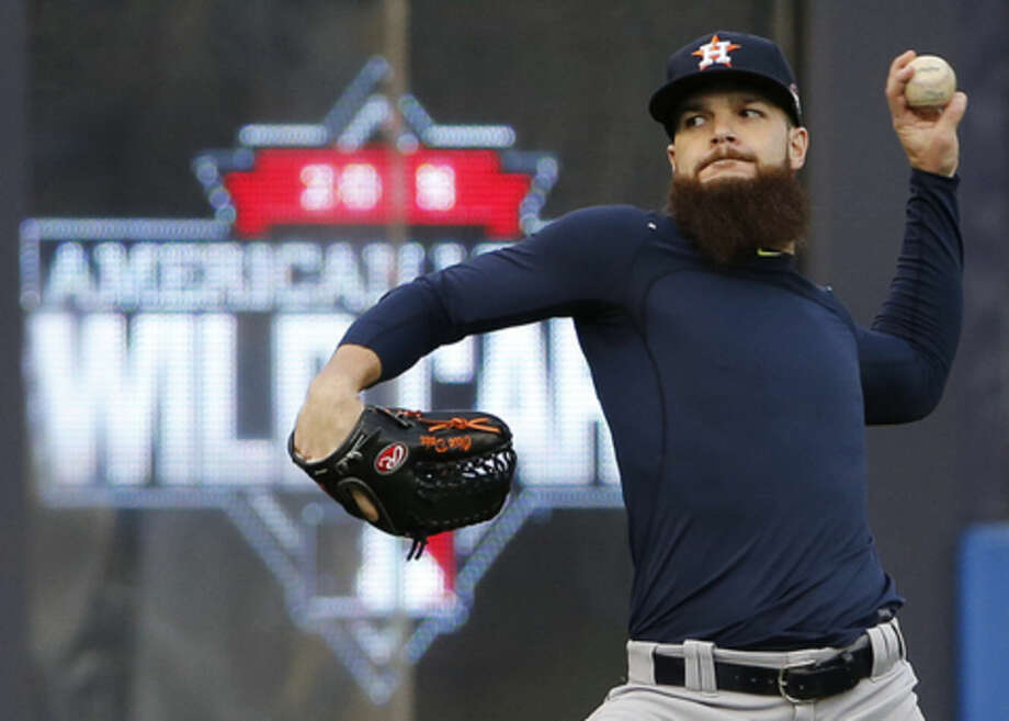 Houston Astros starting pitcher Dallas Keuchel throws in the outfield during a workout at Yankee Stadium in New York, Monday, Oct. 5, 2015, for an American League Wild Card baseball game against the New York Yankees on Tuesday. (AP Photo/Kathy Willens)