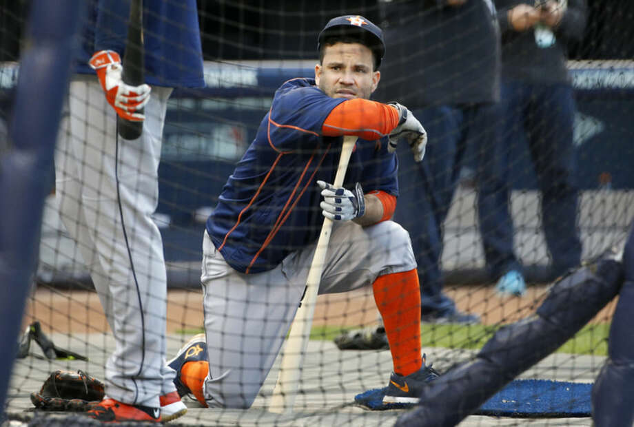 Houston Astros' Jose Altuve waits by the batting cage during a workout at Yankee Stadium in New York, Monday, Oct. 5, 2015, for the American League Wild Card baseball game against the New York Yankees on Tuesday. (AP Photo/Kathy Willens)