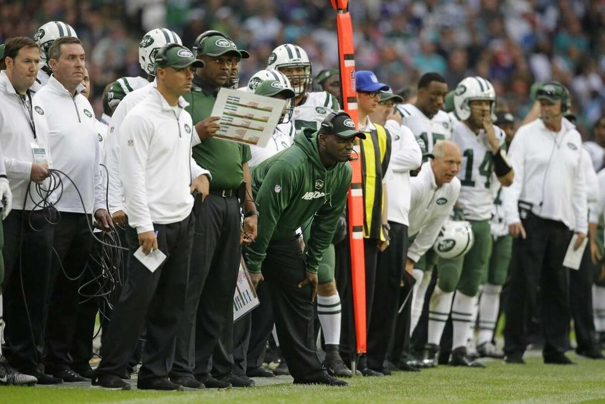 New York Jets head coach Todd Bowles, centre, looks on during the NFL football game between the New York Jets and the Miami Dolphins and at Wembley stadium in London, Sunday, Oct. 4, 2015. (AP Photo/Matt Dunham)