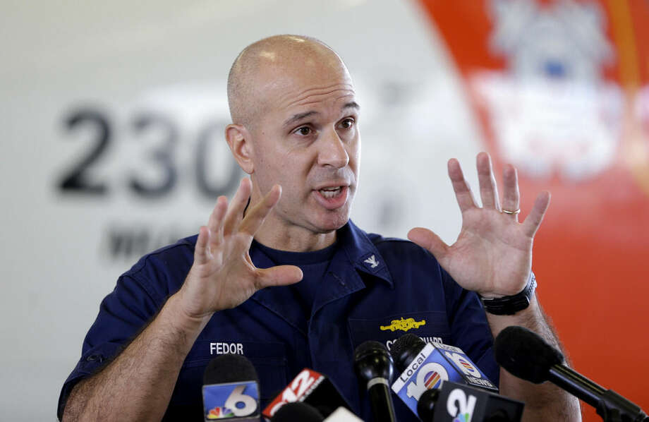 Capt. Mark Fedor, chief of response for the Coast Guard 7th District, talks to reporters during a news conference, Monday, Oct. 5, 2015, at the Opa-locka Airport in Opa-locka, Fla. The Coast Guard said Monday that a U.S. cargo ship carrying 33 people that has been missing since it encountered high winds and heavy seas from Hurricane Joaquin sank and one body was found, but planes and ships will continue searching for the missing crew. (AP Photo/Alan Diaz)