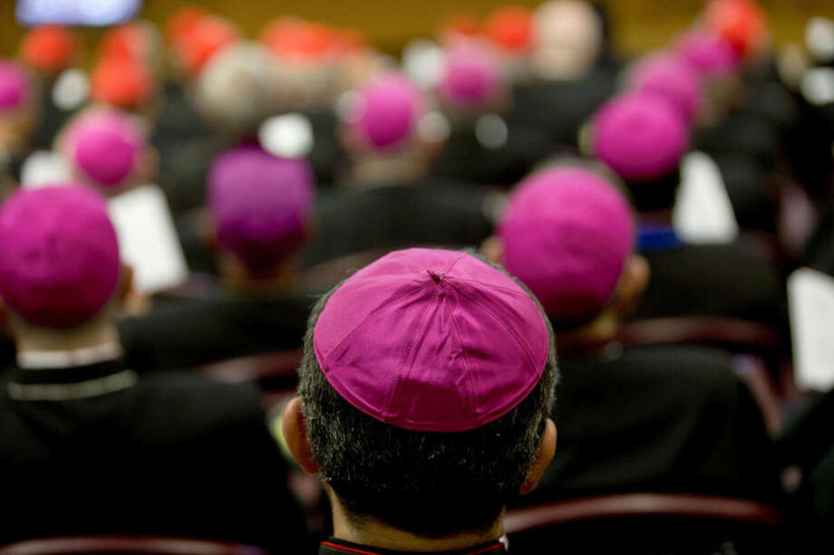 Bishops and cardinals attend the opening session of a two-week bishops' meeting on family issues, at the Vatican, Monday, Oct. 5, 2015. The Synod of bishops and cardinals from around the world is aimed at making the church's teaching on family life relevant to today's Catholic families. (AP Photo/Alessandra Tarantino)
