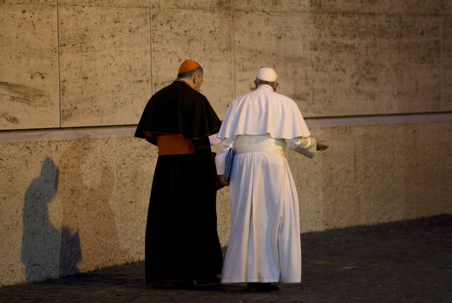 """Pope Francis and Cardinal Pietro Parolin, leave at the end of the afternoon session of the Synod of bishops, at the Vatican, Monday, Oct. 5, 2015. Pope Francis told a contentious gathering of the world's bishops on family issues to put aside their personal prejudices and have the courage and humility to be guided by the """"surprises"""" of God. (AP Photo/Alessandra Tarantino)"""