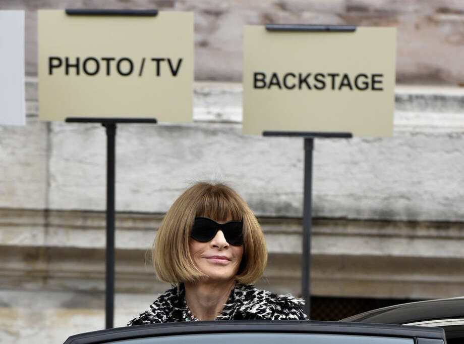 Editor-in-chief of American Vogue Anna Wintour leaves after Stella McCartney's spring-summer 2016 ready-to-wear fashion collection presented during the Paris Fashion Week, Monday, Oct. 5, 2015 in Paris, France. (AP Photo/Zacharie Scheurer)