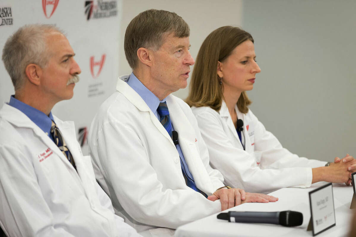 From left, Dr. Mark Rupp, an infectious disease specialist; Dr. Phil Smith, medical director, and Dr. Angela Hewlett, associate medical director, hold a news conference at the Truhlsen Eye Institute in Omaha, Neb. on Sept. 4, 2014. Doctors at the Nebraska Medical Center said they're ready to treat a missionary who was infected with Ebola while serving in Liberia. Dr. Rick Sacra is expected to arrive in Omaha on Friday. (AP Photo/The Omaha World-Herald, Matt Miller)