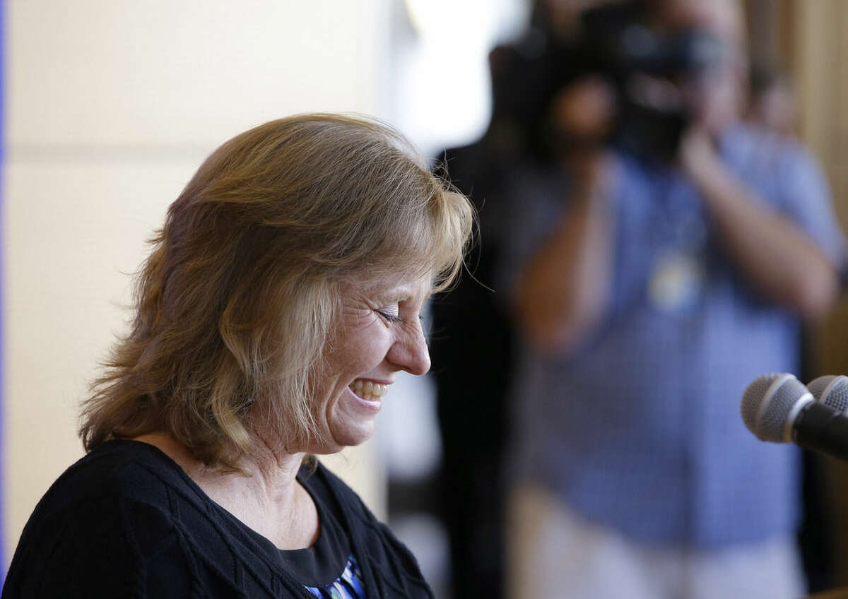 Debbie Sacra, wife of Dr. Rick Sacra, an American doctor who contracted the Ebola virus in Africa, smiles as she speaks about her husband's health while addressing members of the media at the University of Massachusetts Medical School Thursday Sept. 4, 2014 in Worcester, Mass. (AP Photo/Stephan Savoia)