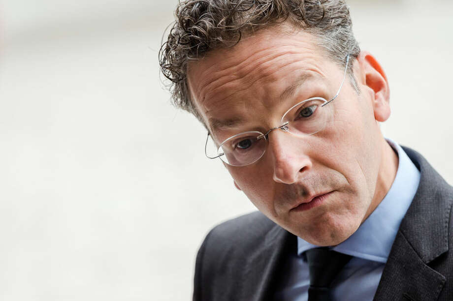 Dutch Finance Minister and chair of the eurogroup finance ministers Jeroen Dijsselbloem talks with journalists as he arrives for a meeting of eurogroup finance ministers at the EU Council building in Luxembourg, Monday, Oct. 5, 2015. (AP Photo/Geert Vanden Wijngaert)