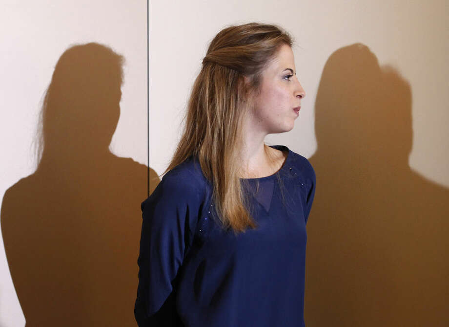 "Olympic bronze medalist Carolina Kostner gives a press conference, in Milan, Italy, Tuesday, Oct. 6, 2015. Figure skating champion Kostner says she has ""the desire"" to return to competition after serving a suspension for helping her ex-boyfriend evade doping controls. (AP Photo/Antonio Calanni)"