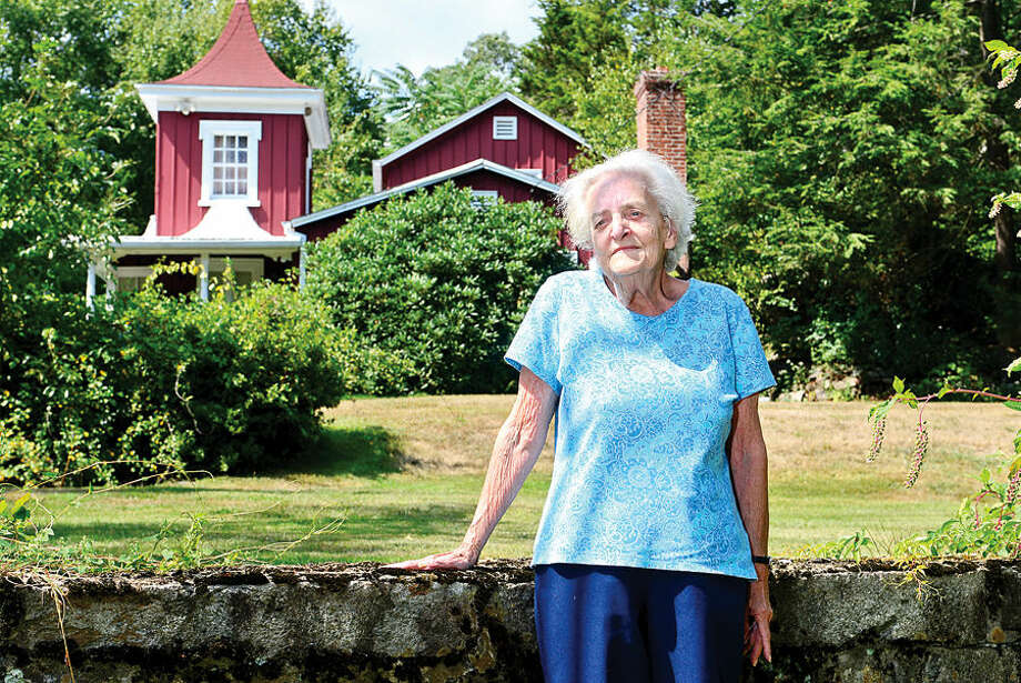 Hour photo / Erik Trautmann Joan Tortora, a descendent of the builder of the house on Al Madany Islamic Center property at 127 Fillow St., believes the house is historical and says it was home to descendents of New England colonist John Cotton Mather.