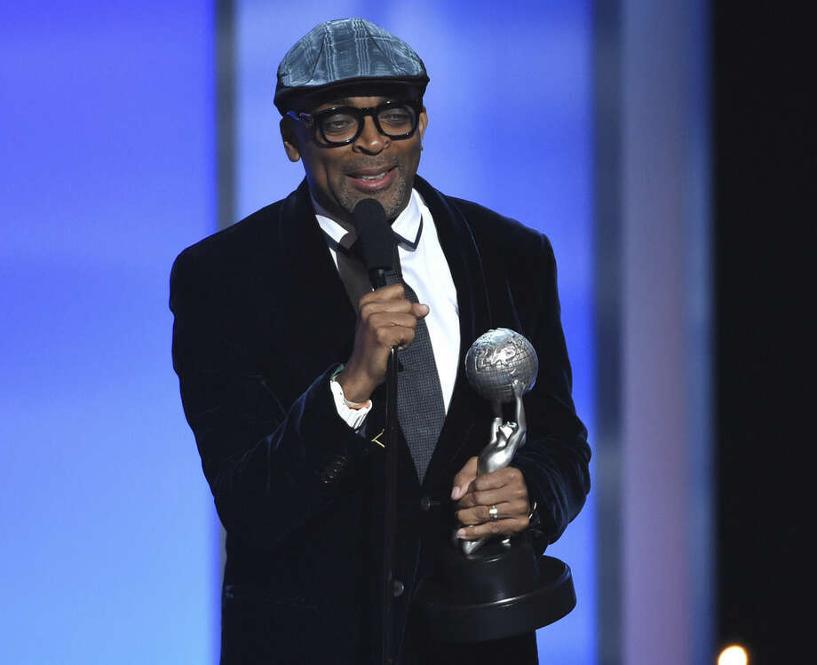 FILE - In this Friday, Feb. 6, 2015, file photo, Spike Lee accepts the President's Award on stage at the 46th NAACP Image Awards at the Pasadena Civic Auditorium in Pasadena, Calif. Filmmaker, teacher, honorary Oscar winner, and crazy New York sports fan Lee is the next grand marshal of the New York City Marathon, race officials announced, Monday, Oct. 5, 2015. (Photo by Chris Pizzello/Invision/AP, File)