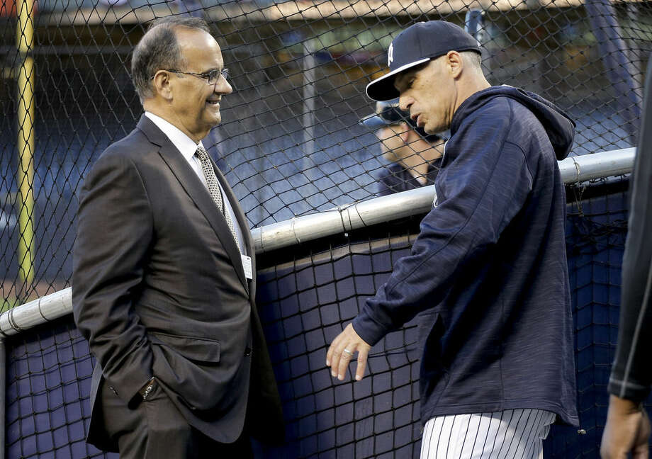 Former New York Yankees manager Joe Torre, left, talks with Yankees manager Joe Girardi before the start of of the American League wild card baseball game against the Houston Astros, Tuesday, Oct. 6, 2015, in New York. (AP Photo/Julie Jacobson)