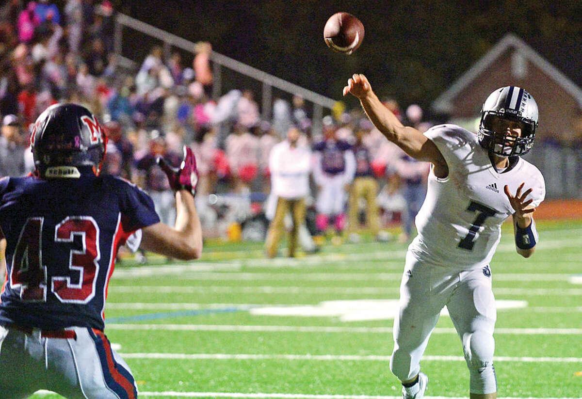 Hour photo / Erik Trautmann #7 for Staples High School, Andrew Speed, throws a touchdown pass during their game Brien McMahon in Norwalk Friday night.