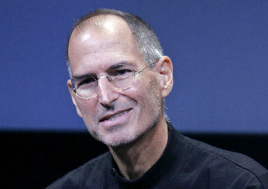 "FILE - In this Oct. 14, 2008 file photo, Apple CEO Steve Jobs smiles during a product announcement at Apple headquarters in Cupertino, Calif. Jobs became renowned for conjuring a ""reality distortion field"" that made people believe whatever he wanted. If he were still around, it's easy to imagine that Jobs would be summoning all his powers of persuasion to protect a legacy that's getting muddied with each cinematic take on his fascinating life. (AP Photo/Paul Sakuma, File)"