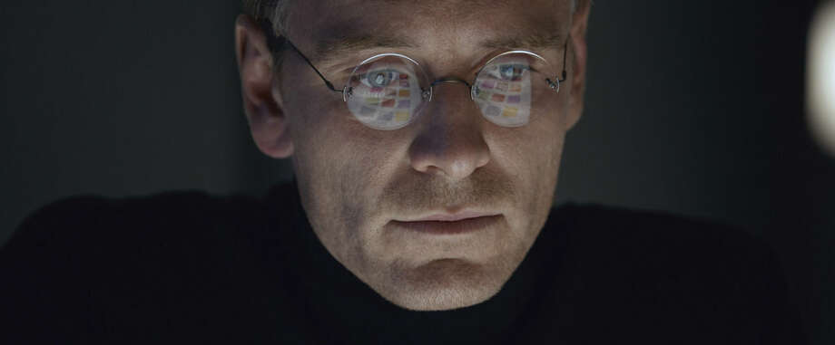 "In this image released by Universal Pictures, Michael Fassbender stars as Steve Jobs in a scene from the film, ""Steve Jobs."" The movie opens in U.S. theaters on Friday, Oct. 9, 2015. (Universal Pictures via AP)"