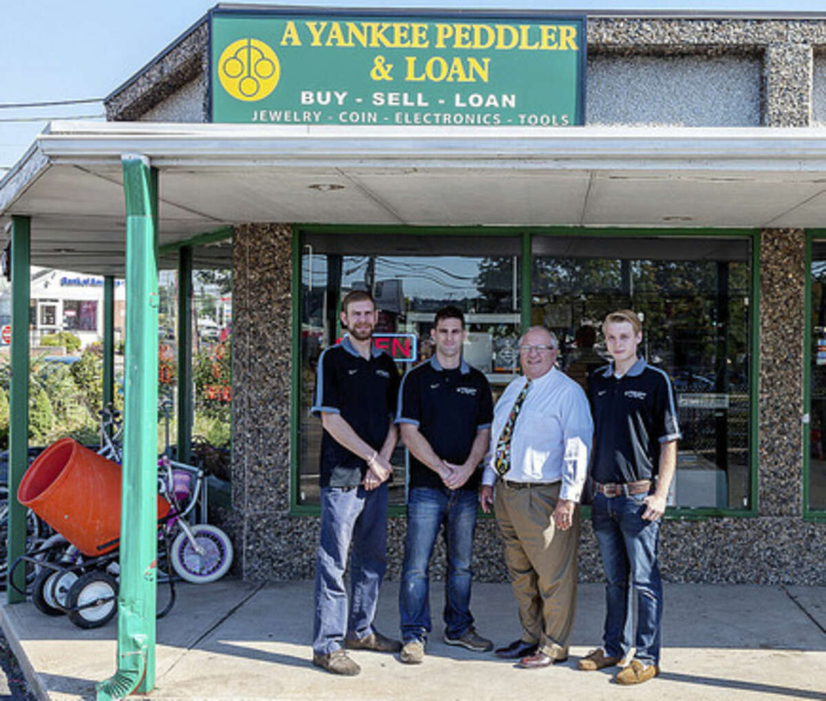 Contributed photo A Yankee Peddler & Loan employees (left to right) Peter Bafundo, Matt Luczak, Alexander DeLucia and Josh Bryant.