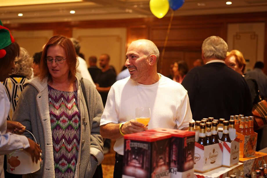 Scott Dobson samples a brew during the Norwalk Police Activies League's Beer Tasting at the Norwalk Inn Thursday evening. Hour Photo / Danielle Calloway