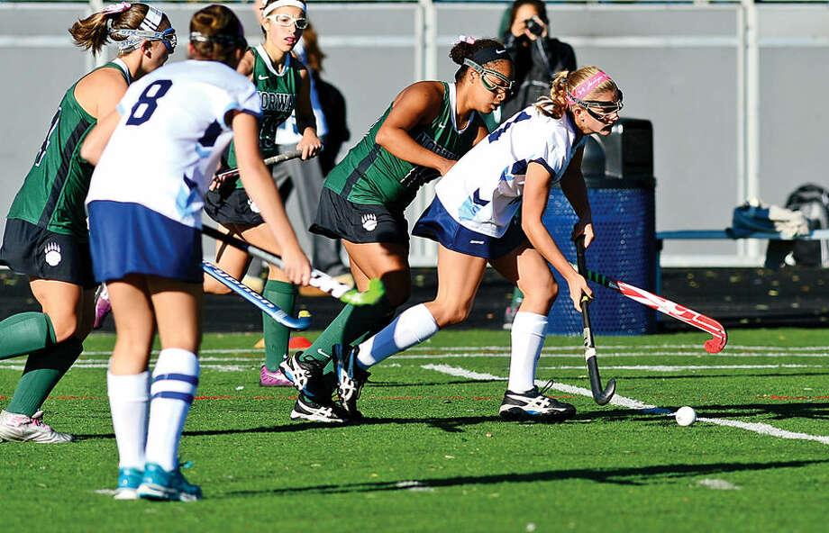 Hour photo / Erik Trautmann The Norwalk High School field hockey team takes on Wilton at Fujitani Stadium Saturday.