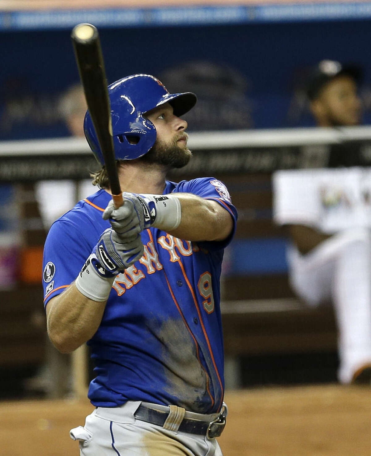 New York Mets' Kirk Nieuwenhuis watches his two-run home run against the Miami Marlins in the fourth inning of a baseball game in Miami, Wednesday, Sept. 3, 2014. Travis d'Arnaud scored on the home run. (AP Photo/Alan Diaz)