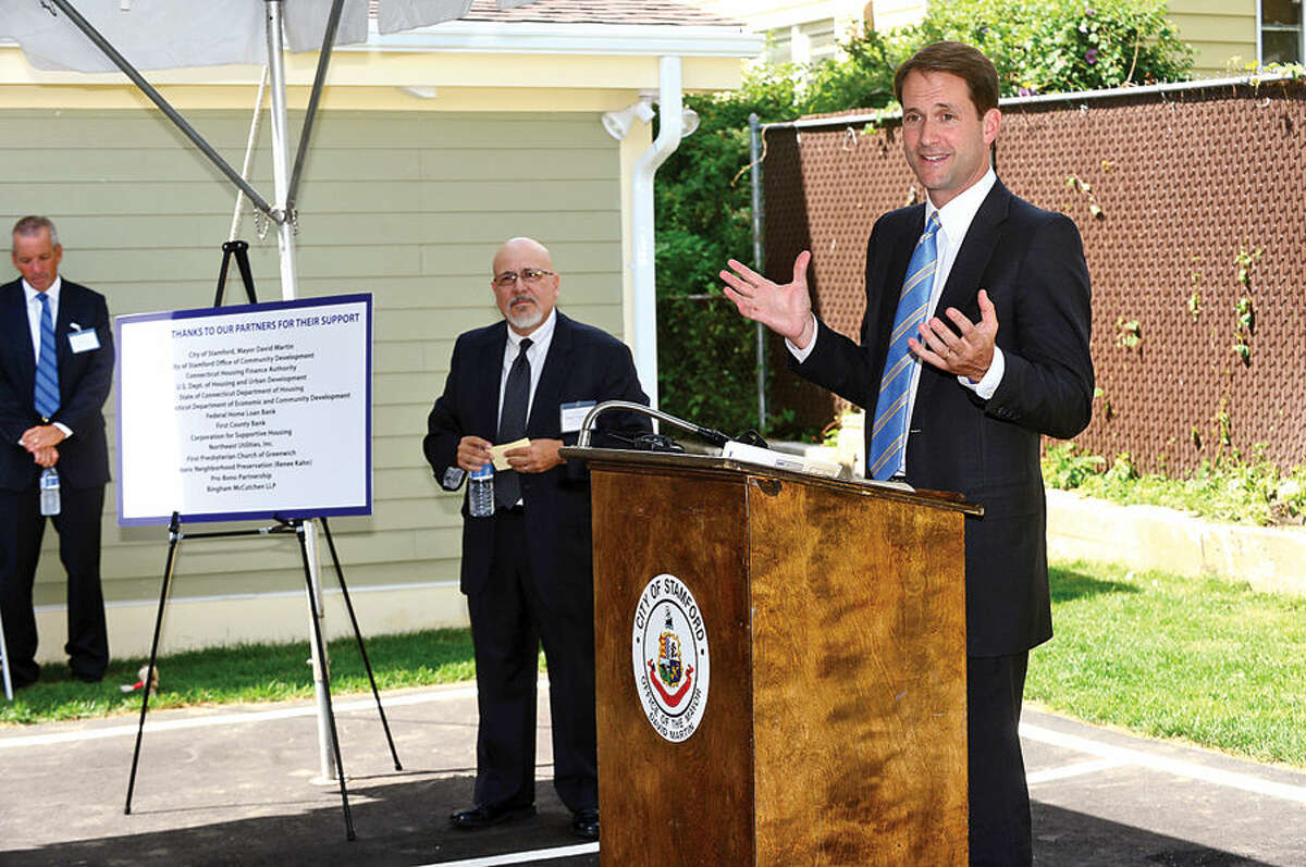 Congressman Jim Himes speaks at the Beacon II, the newest affordable housing site operated by the Shelter for the Homeless, during a ribbon cutting ceremony at the Ann Street home Wednesday afternoon. The property has been fully renovated with state and federal assistance and converted into three affordable apartments, including a fully handicap-accessible unit.