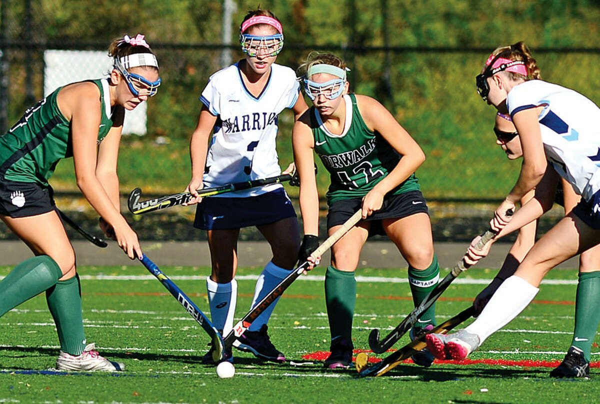 Hour photo / Erik Trautmann The Norwalk High School field hockey team takes on Wilton at Fujitani Stadium Saturday.