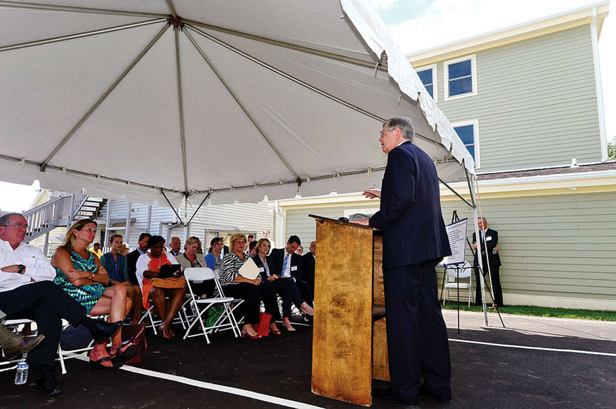 Mayor David Martin speaks at the Beacon II, the newest affordable housing site operated by the Shelter for the Homeless, during a ribbon cutting ceremony at the Ann Street home Wednesday afternoon. The property has been fully renovated with state and federal assistance and converted into three affordable apartments, including a fully handicap-accessible unit.