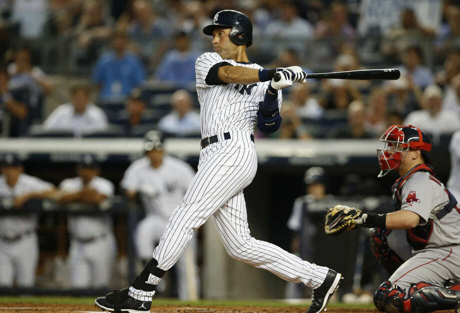 New York Yankees' Derek Jeter hits a first-inning single in a baseball game against the Boston Red Sox at Yankee Stadium in New York, Wednesday, Sept. 3, 2014. (AP Photo/Kathy Willens)