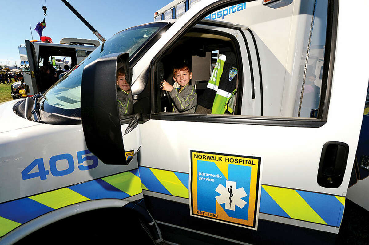 Hour photo / Erik Trautmann Jayden Gellingten 10, checks out a Norwalk Hospital ambulance at the Human Services Council's 4th Annual KIDZFEST Touch-A-Truck & More Fundraiser to benefit Children's Connection Saturday, October 10, 2015 at Taylor Farm Park in Norwalk. The hands-on interactive family event featured over 60 vehicles that dig, climb, rescue, crunch, honk and fly.