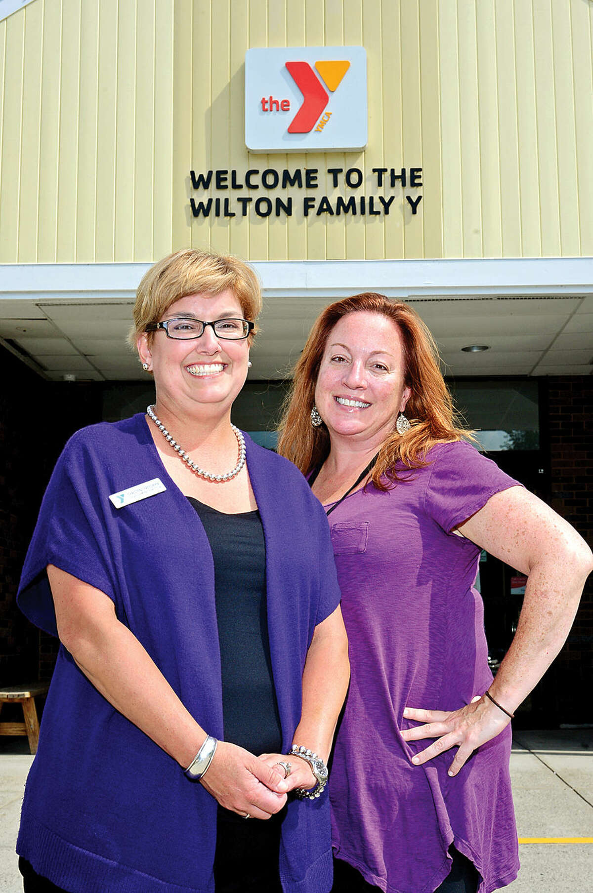 Christene Freedman, the new director of development at the Wilton Family YMCA, with her Associate Director of Development Laura Downing.