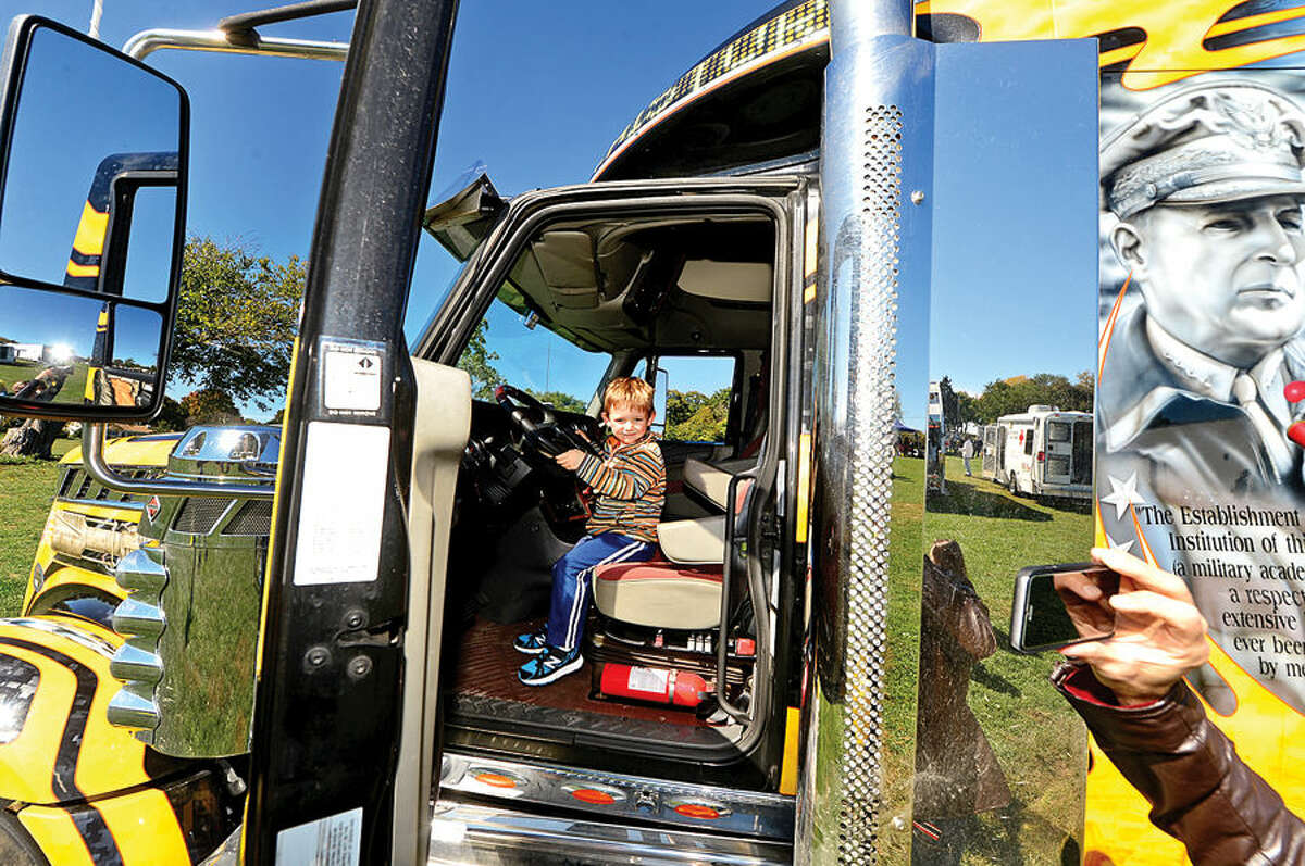 Hour photo / Erik Trautmann Elliot Drene, 3, sits in a semi from the Westpoint Army Football Team at the Human Services Council's 4th Annual KIDZFEST Touch-A-Truck & More Fundraiser to benefit Children's Connection Saturday, October 10, 2015 at Taylor Farm Park in Norwalk. The hands-on interactive family event featured over 60 vehicles that dig, climb, rescue, crunch, honk and fly.