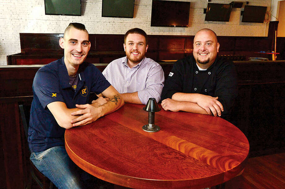 Hour photo / Erik Trautmann Owners, Matt Bacco, Casey Dohme and Jamie Pantanella wil be opening a new sports bar, Blind Rhino, on North Main St in SoNo next Friday