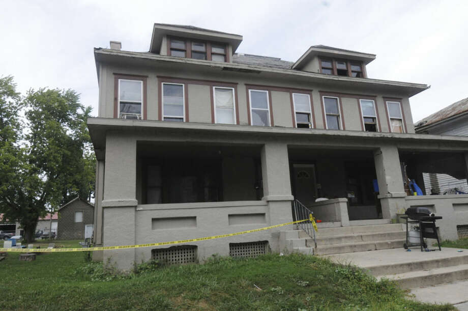 In this photo taken on Tuesday, Sept. 2, 2014, police tape cordons off a home in Bucyrus, Ohio, where one of four men were found beaten to death Monday. Authorities in the northern Ohio town are asking for the public's help in solving the slayings of four men, between the ages of 50 and 70, who where were found beaten to death in separate homes this week. (AP Photo/News Journal, Daniel Melograna) NO SALES
