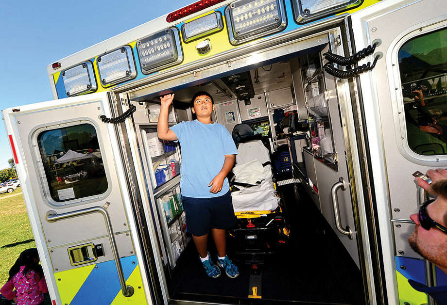 Hour photo / Erik Trautmann Ryan Lanche, 10, checks out a Norwalk Hospital ambulance at the Human Services Council's 4th Annual KIDZFEST Touch-A-Truck & More Fundraiser to benefit Children's Connection Saturday, October 10, 2015 at Taylor Farm Park in Norwalk. The hands-on interactive family event featured over 60 vehicles that dig, climb, rescue, crunch, honk and fly.