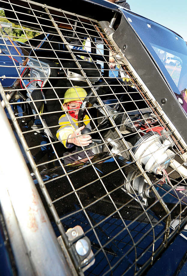 Hour photo / Erik Trautmann Conor Wolff, 4, sits in a NASCAR SK Modified at the Human Services Council's 4th Annual KIDZFEST Touch-A-Truck & More Fundraiser to benefit Children's Connection Saturday, October 10, 2015 at Taylor Farm Park in Norwalk. The hands-on interactive family event featured over 60 vehicles that dig, climb, rescue, crunch, honk and fly.