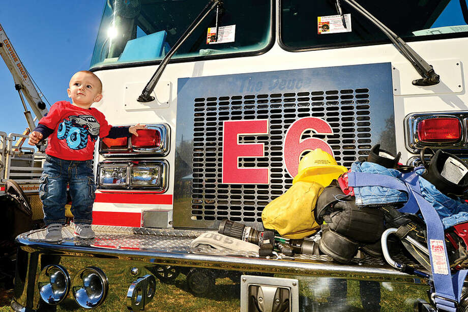 Hour photo / Erik Trautmann Ziggy Sommer, 1, checks out Norwalk Fire Department's #3 Engine at the Human Services Council's 4th Annual KIDZFEST Touch-A-Truck & More Fundraiser to benefit Children's Connection Saturday, October 10, 2015 at Taylor Farm Park in Norwalk. The hands-on interactive family event featured over 60 vehicles that dig, climb, rescue, crunch, honk and fly.