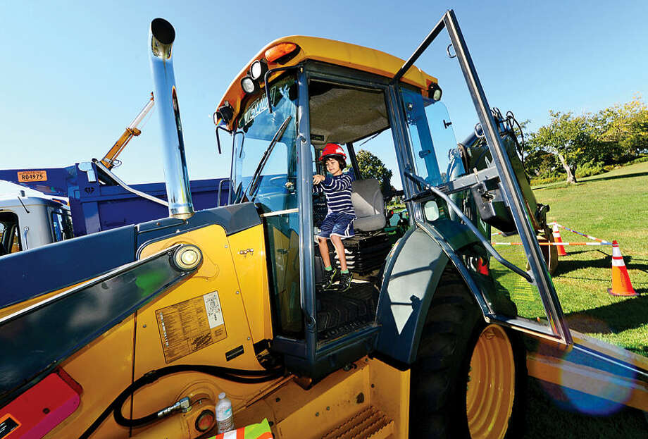 Hour photo / Erik Trautmann Hebert Chavez tries his hand at the wheel of a Derrano Construction backhoe at the Human Services Council's 4th Annual KIDZFEST Touch-A-Truck & More Fundraiser to benefit Children's Connection Saturday, October 10, 2015 at Taylor Farm Park in Norwalk. The hands-on interactive family event featured over 60 vehicles that dig, climb, rescue, crunch, honk and fly.