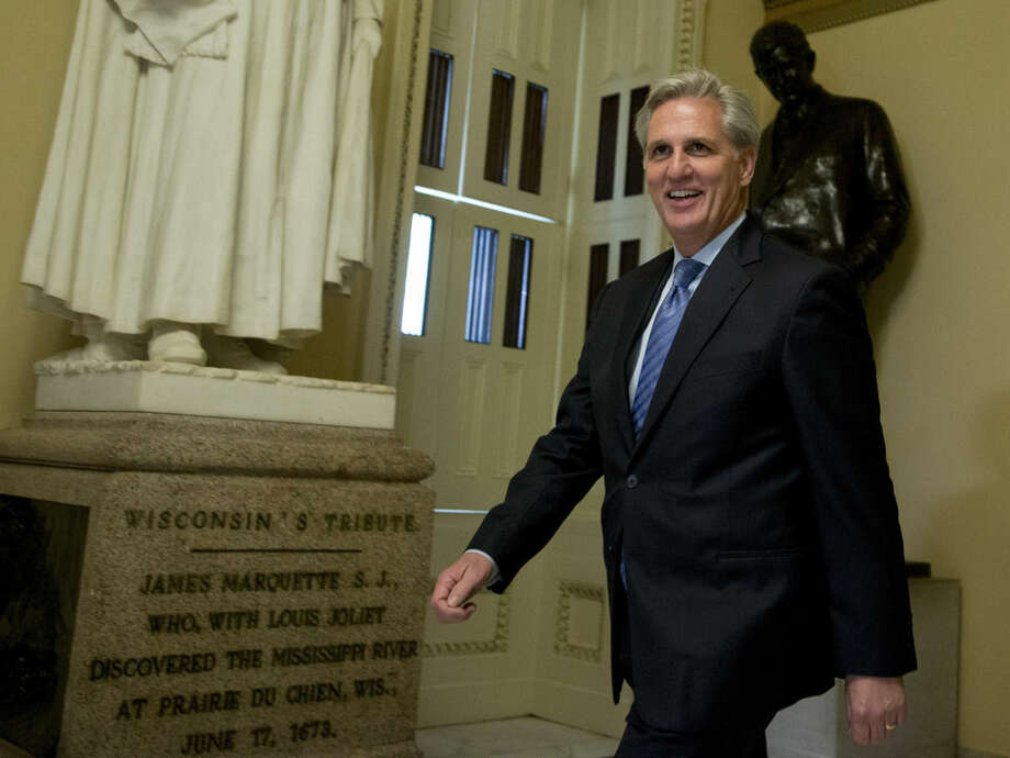 House Majority Leader Kevin McCarthy of Calif. walks toward the House Chamber on Capitol Hill in Washington, Friday, Oct. 9, 2015. In the unruly House, Republicans enjoy a near-historic majority, yet deep divisions between ultra-conservatives and more traditional GOP lawmakers have left them at a loss over who should be in charge. (AP Photo/Manuel Balce Ceneta)