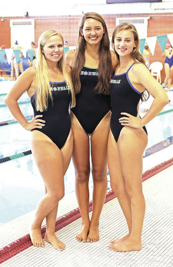 Hour Photo/Danielle CallowayFrom left, Paige DeLago, Katherine Wargo and Olivia Haskell are the tri-captains of this year's Norwalk High-Brien McMahon co-op girls swim team.