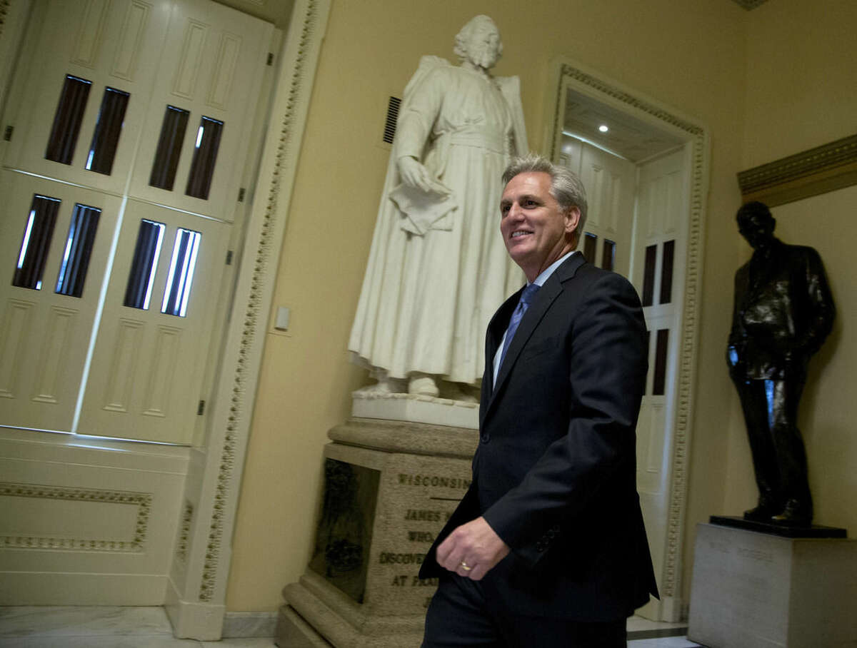 House Majority Leader Kevin McCarthy of Calif. walks towards the House Chamber on Capitol Hill in Washington, Friday, Oct. 9, 2015. In the unruly House, Republicans enjoy a near-historic majority, yet deep divisions between ultra-conservatives and more traditional GOP lawmakers have left them at a loss over who should be in charge. (AP Photo/Manuel Balce Ceneta)