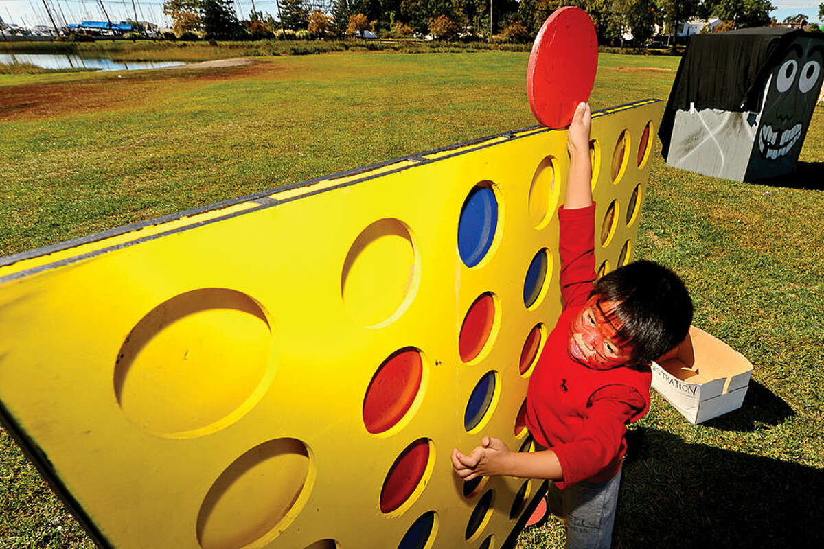 Hour photo / Erik Trautmann Jayden Chedo, 4, tries a giant Connect Four puzzle at the Human Services Council's 4th Annual KIDZFEST Touch-A-Truck & More Fundraiser to benefit Children's Connection Saturday, October 10, 2015 at Taylor Farm Park in Norwalk. The hands-on interactive family event featured over 60 vehicles that dig, climb, rescue, crunch, honk and fly.