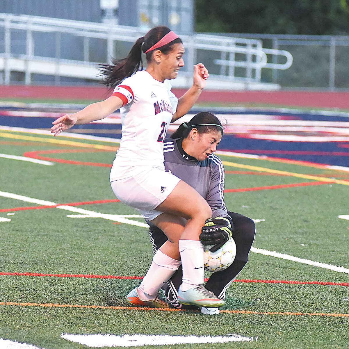 Hour photo/John Nash - Norwalk goalkeeper Imelda Lazaro, right, collides with Brien McMahon's Olivia Rosado as the two chase down a ball during Saturday's intra-city rivalry game at Casagrande Field. The two players were named their respective teams MVPs in a 1-1 tie.