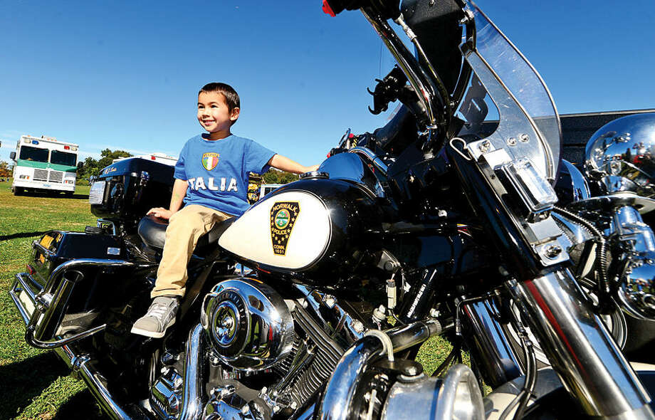 Hour photo / Erik Trautmann 4 year old Dash Keffer hops aboard a Norwalk Police Department motorcycle at the Human Services Council's 4th Annual KIDZFEST Touch-A-Truck & More Fundraiser to benefit Children's Connection Saturday, October 10, 2015 at Taylor Farm Park in Norwalk. The hands-on interactive family event featured over 60 vehicles that dig, climb, rescue, crunch, honk and fly.