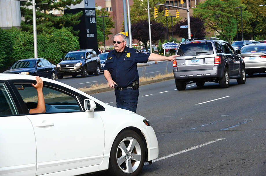 """Sgt. Richard Phalen and the Stamford Police Department kicks off an Anti-Texting Enforcement Project, as part of the """"U Drive. U Text. U Pay."""" Wednesday morning on Elm Street."""