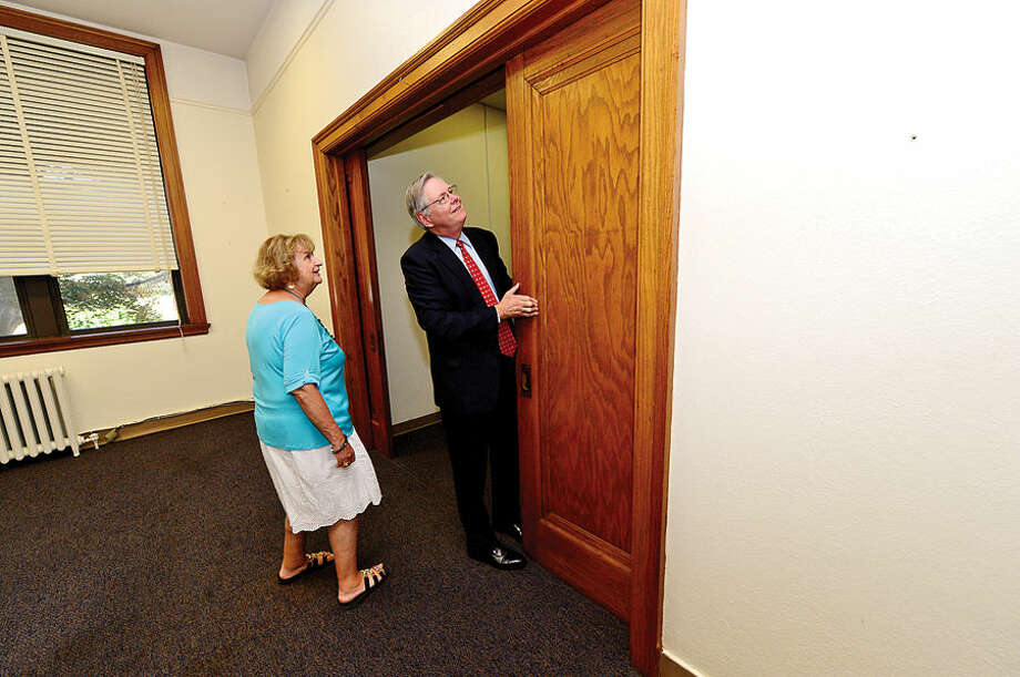 Hour photo / Erik Trautmann Stamford Mayor David Martin tours the former Sacred Heart Academy with Stamford Board representative Eileen Heaphy following a presentation of the keys ceremony at the former Sacred Heart Academy which the city purchased Thursday .