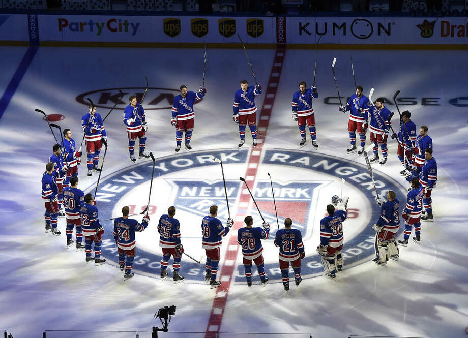 The New York Rangers raise their sticks into the air after team introductions on home opening night of an NHL hockey game against the Columbus Blue Jackets Saturday, Oct. 10, 2015, in New York. (AP Photo/Kathy Kmonicek)