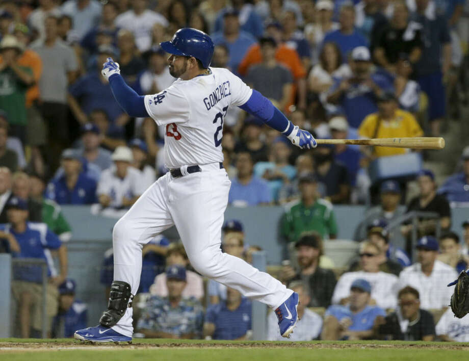 Los Angeles Dodgers' Adrian Gonzalez watches his two-RBI double against the New York Mets during the seventh inning in Game 2 of baseball's National League Division Series, Saturday, Oct. 10, 2015 in Los Angeles. (AP Photo/Lenny Ignelzi)