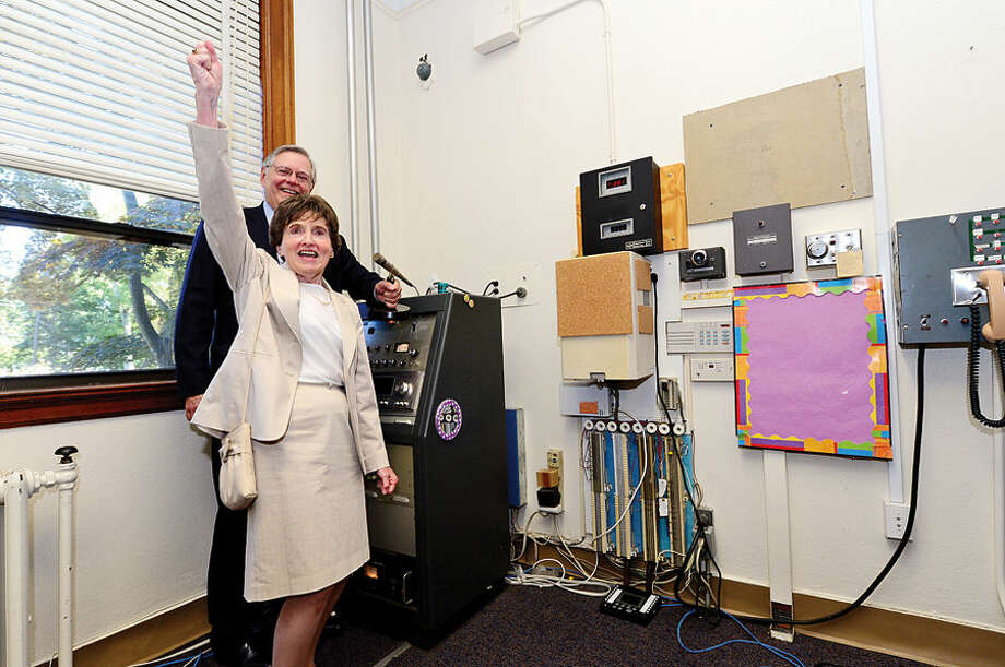 Graduate of Sacred Heart Academy and Stamford board representative, Mary Savage, sings the school's alma mater with Mayor David Martin following a presentation of the keys ceremony at the former Academy which the city purchased Thursday.