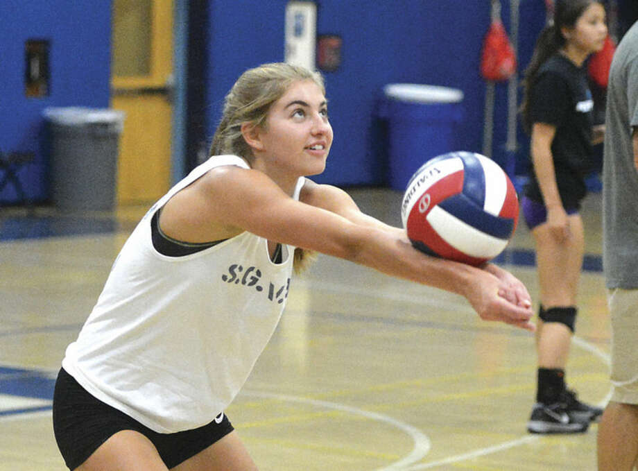 Hour Photo/Alex von KleydorffStaples' Elizabeth Knoll hits a ball at practice last week. Knoll enters 2014 with three years of varsity experience.