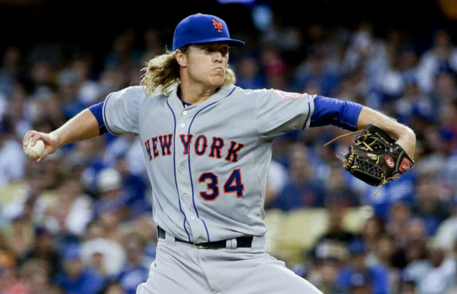 New York Mets starting pitcher Noah Syndergaard throws against the Los Angeles Dodgers during the first inning in Game 2 of baseball's National League Division Series, Saturday, Oct. 10, 2015 in Los Angeles. (AP Photo/Lenny Ignelzi)