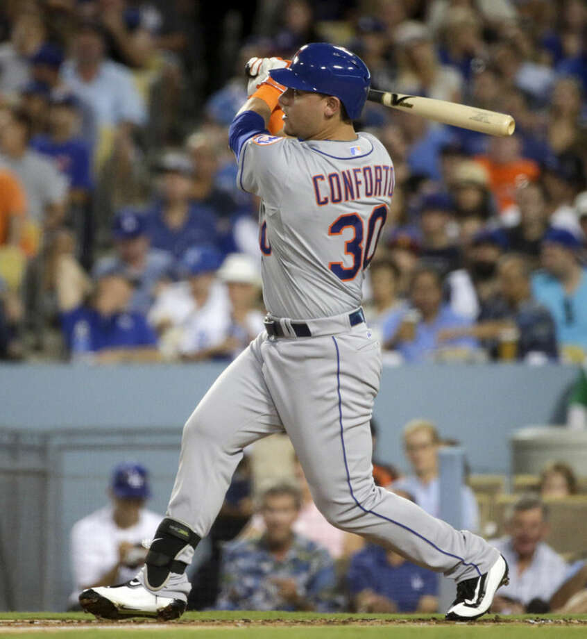 New York Mets' Michael Conforto watches his home run against the Los Angeles Dodgers during the second inning in Game 2 of baseball's National League Division Series, Saturday, Oct. 10, 2015 in Los Angeles. (AP Photo/Lenny Ignelzi)